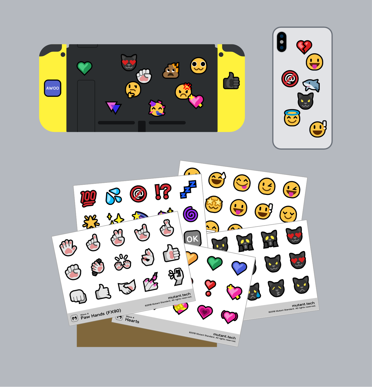 Below them are a variety of sticker sheets splayed out, each sheet has a grid of 15 emoji, and a little strip on the bottom with a title for each sheet.